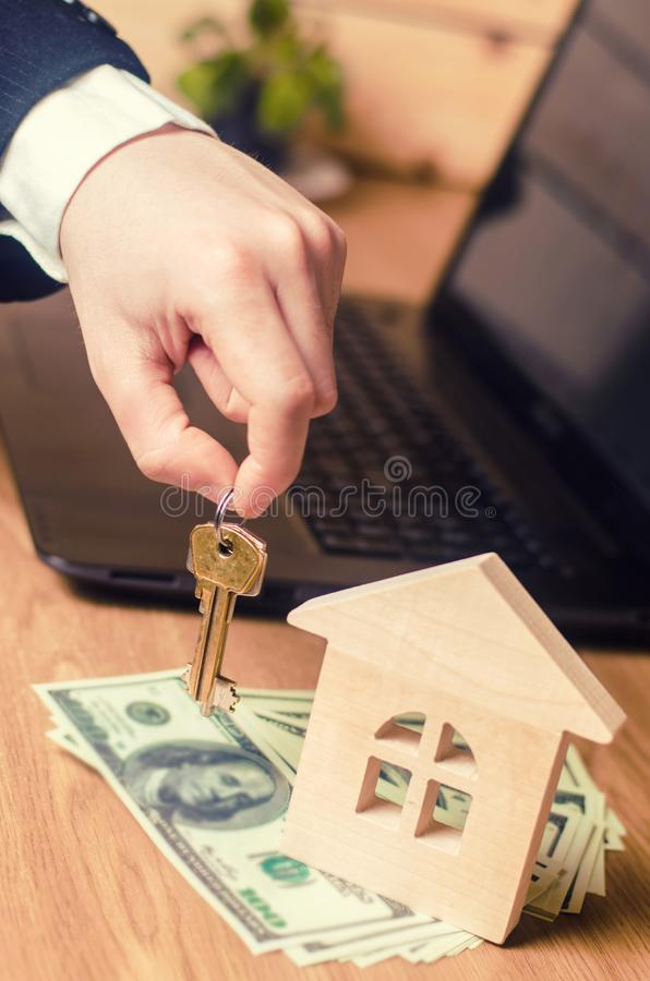 Real estate concept. Buying and selling homes. Rent apartment. Sale of property. Mortgage and payment of taxes. Debt and loan. Pur. Chase. Home sold. Realtor and stock image