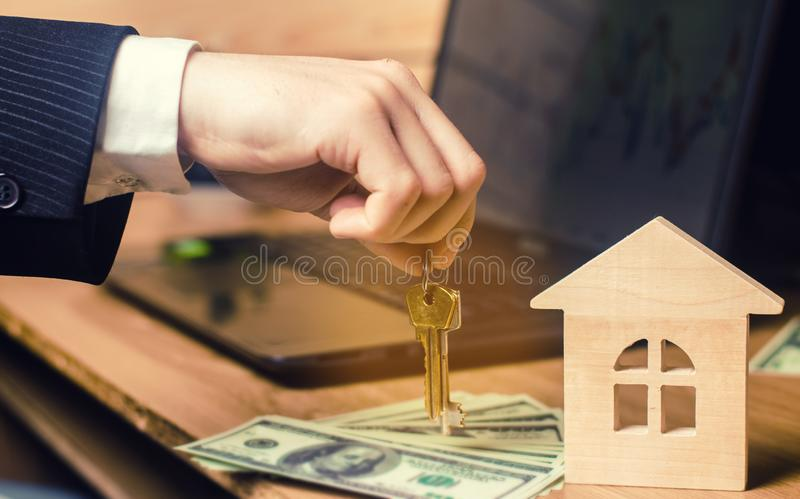 Real estate concept. Buying and selling homes. Rent apartment. Sale of property. Mortgage and payment of taxes. Debt and loan. Pur. Chase. Home sold. Realtor and royalty free stock photos