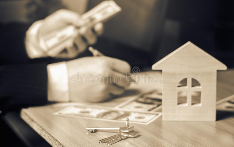 Real estate concept. Buying and selling homes. Rent apartment. Sale of property. Mortgage and payment of taxes. Debt and loan. Pur. Chase. Home sold. Realtor and royalty free stock photo