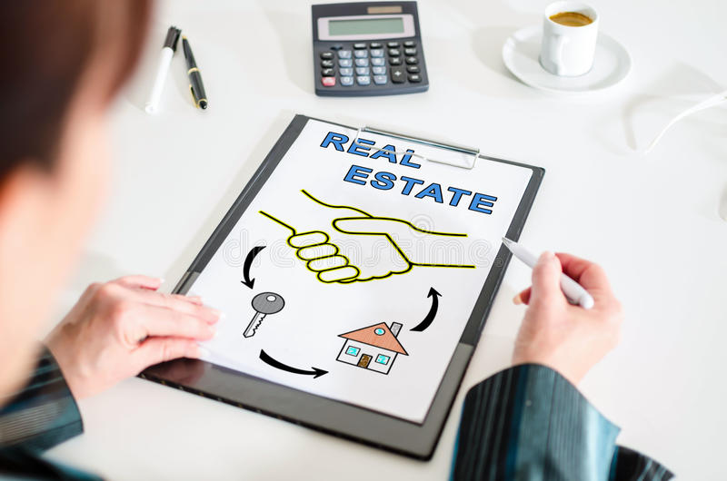 Real estate concept on a clipboard. Woman looking at a real estate concept stock photo
