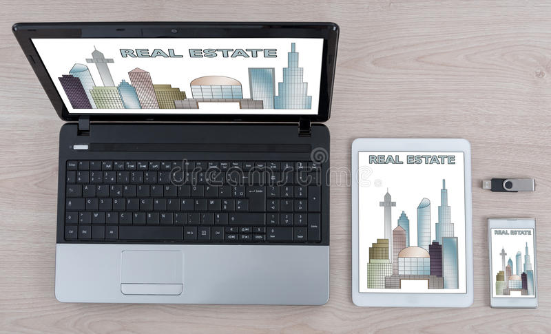 Real estate concept on different information technology devices. Real estate concept shown on different information technology devices royalty free stock photos