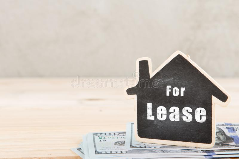 Real estate concept - little house with inscription For Lease. Real estate concept little house with inscription For Lease, rent, home, housing, rental, property royalty free stock images