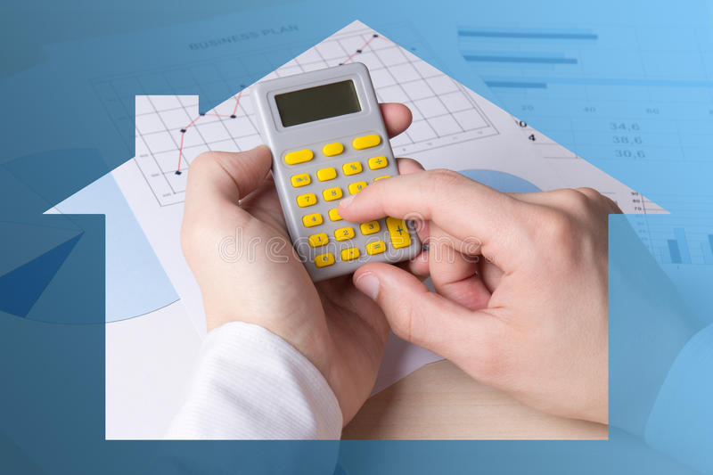 Real estate concept - male hands accounting something with calculator. Real estate concept - close up of male hands accounting something with calculator stock images