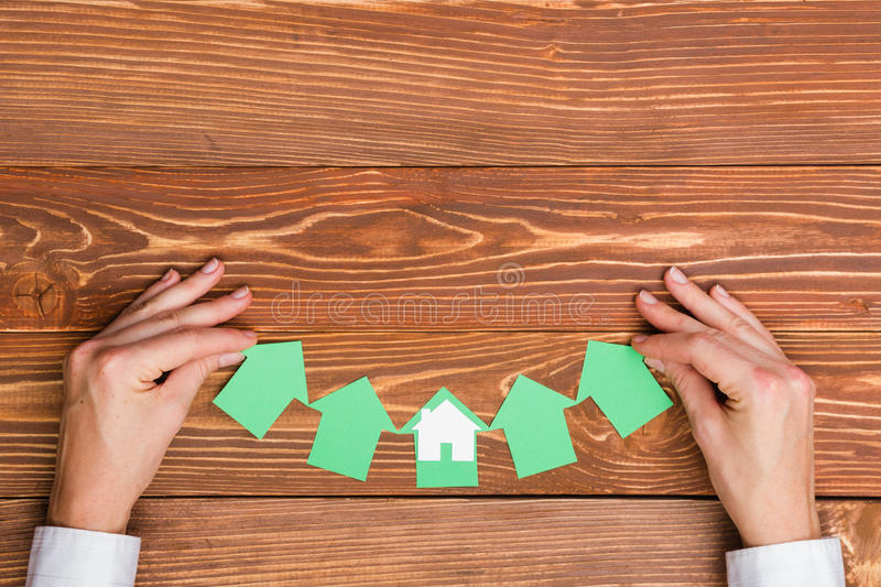Real Estate Concept. Paper house figure and blank business card. Paper house figure and blank business card on wooden background. Real Estate Concept. Top view royalty free stock photo
