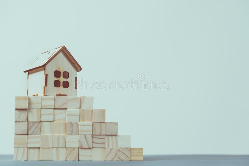 Real estate concept. Small toy wooden house with keys. With copy space royalty free stock images