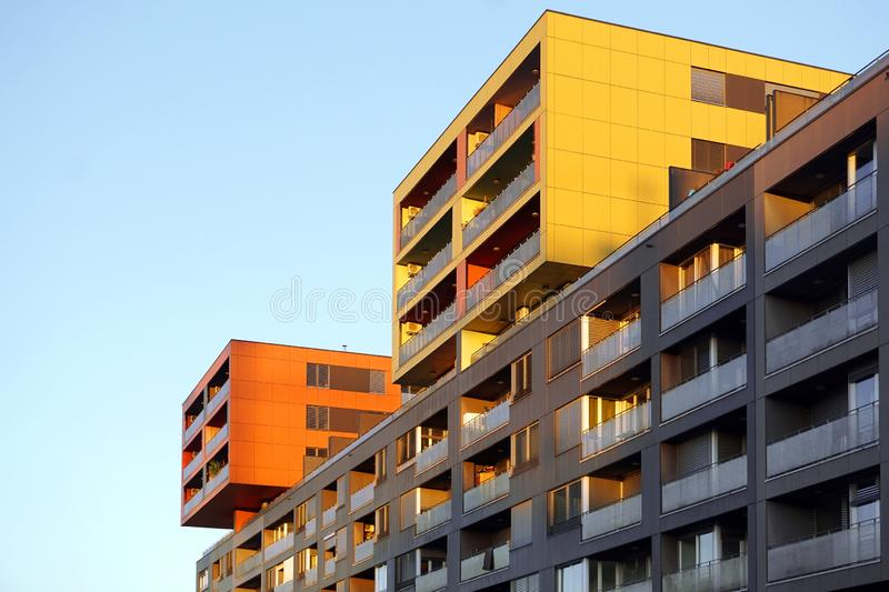 Modern family apartment building against blue sky at sunset stock photos