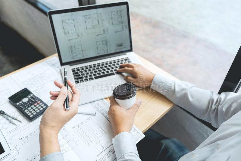 Real-estate concept, Two engineer and architect discussing blueprints data working and digital tablet on construction building. Project royalty free stock photos