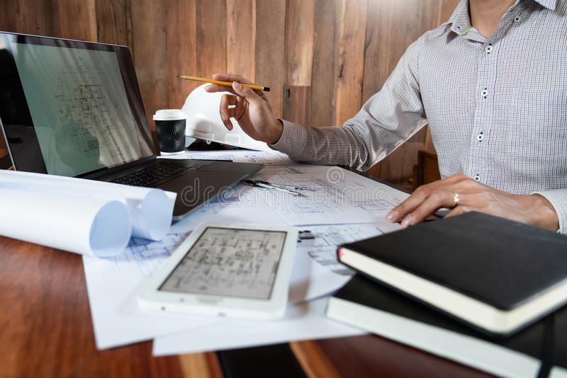Real-estate concept, Two engineer and architect discussing blueprints data working and digital tablet on construction building. Project royalty free stock images