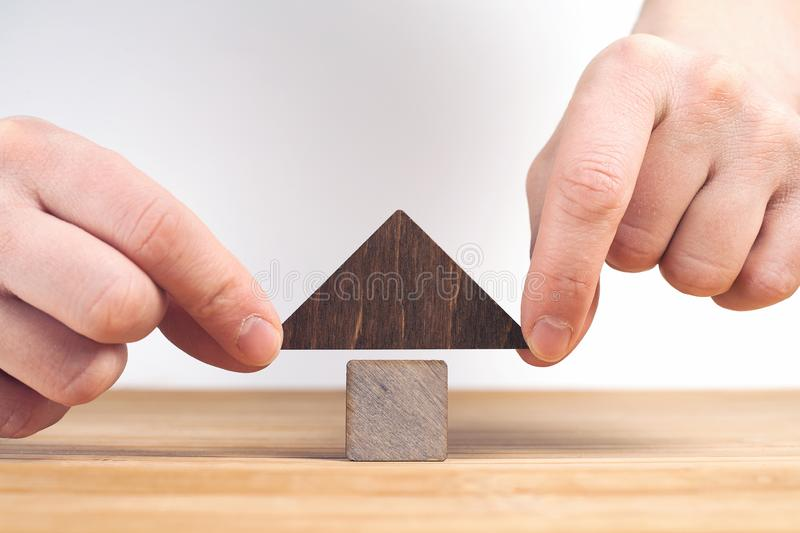 Real estate concept. Wooden house model on wooden table, white background royalty free stock photography