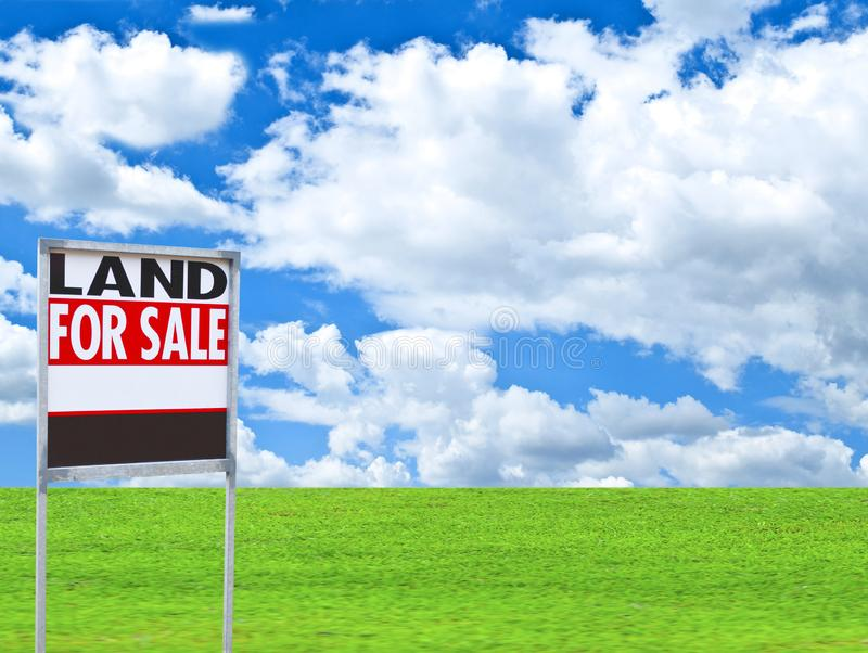 Real estate conceptual image - \'FOR SALE\' sign on empty meadow stock images