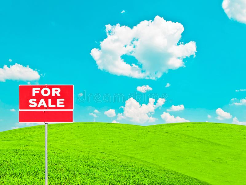 Real estate conceptual image - \'FOR SALE\' sign on empty meadow royalty free stock photo