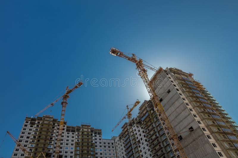 Real estate construction. Construction of new real estate apartment buildings over blue sky royalty free stock photo