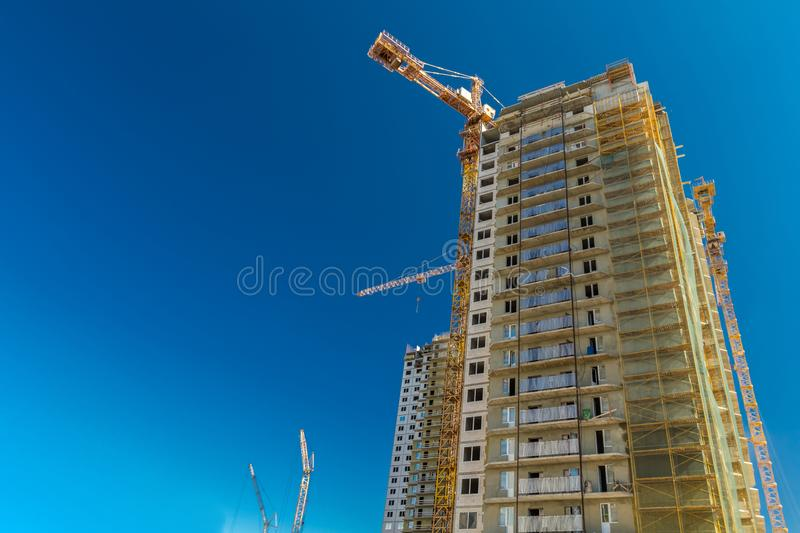 Real estate construction. Construction of new real estate apartment buildings over blue sky stock image