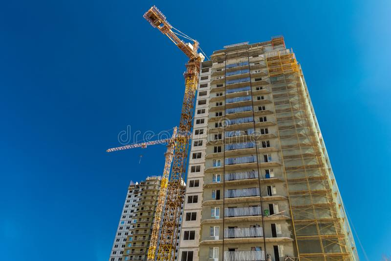 Real estate construction. Construction of new real estate apartment buildings over blue sky royalty free stock image