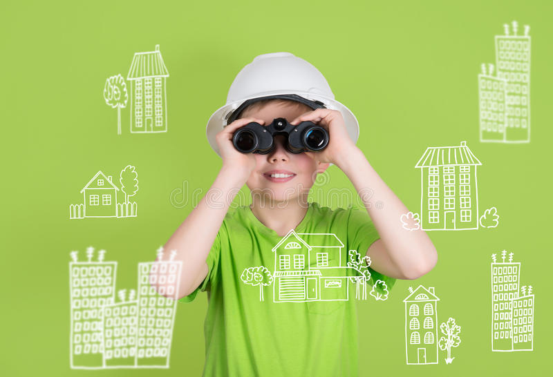 Real estate construction engineering concept. Cute boy with binoculars on green background looking for future home. royalty free stock images