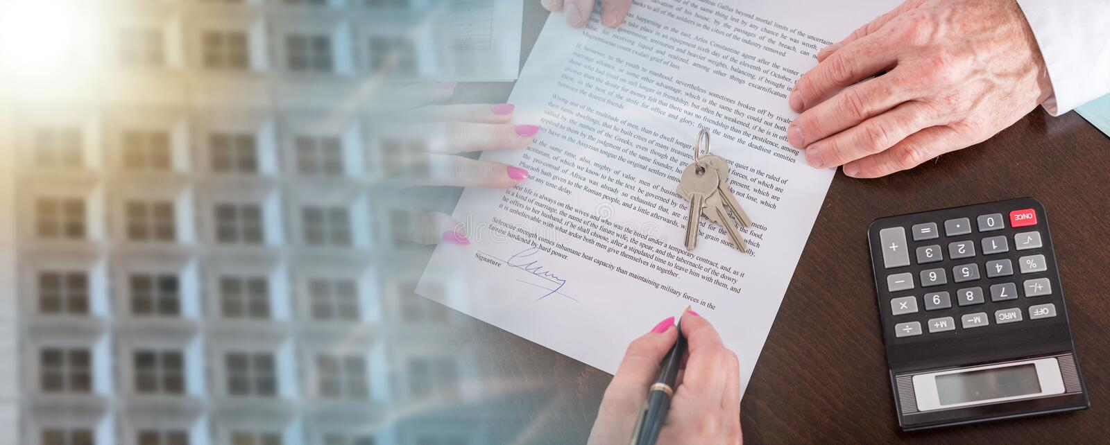 Signature of a real estate contract; multiple exposure stock photography