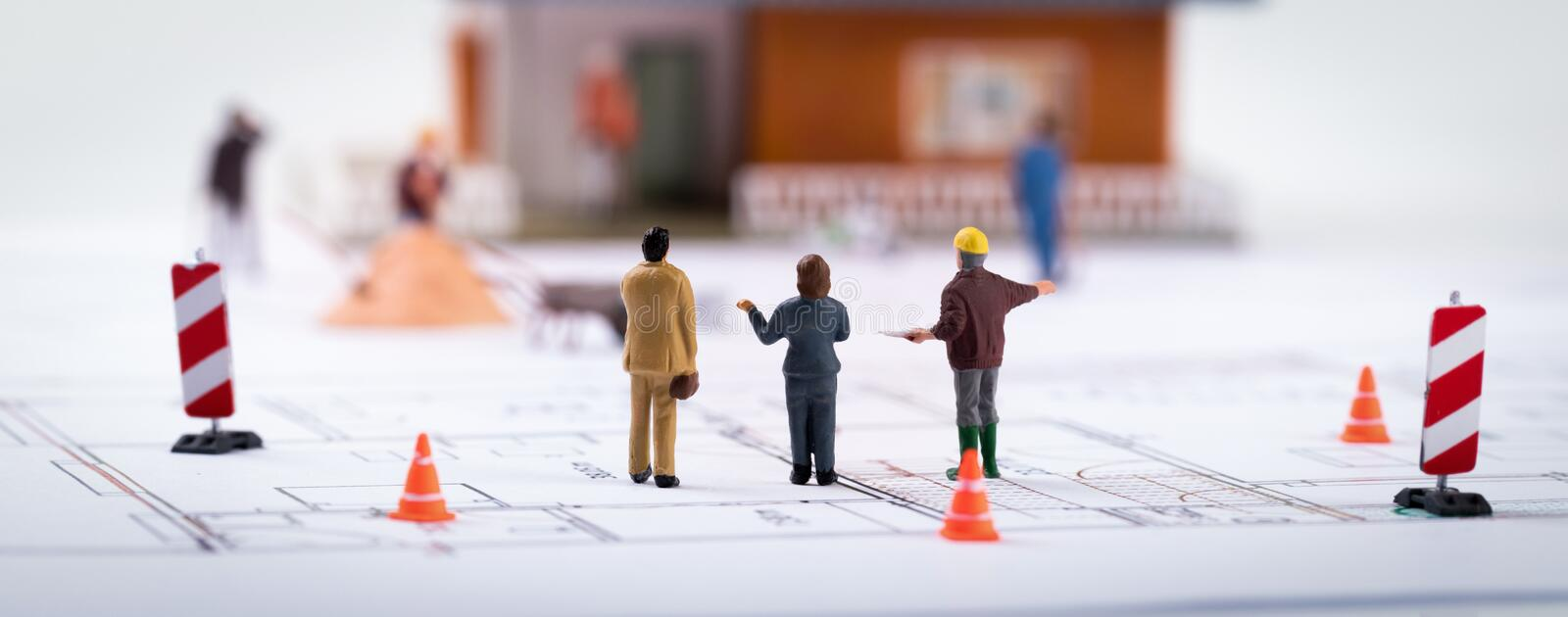 Real estate development - construction manager with customers at stock photos