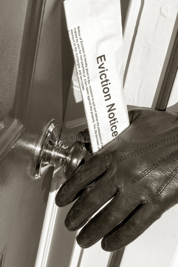 Real Estate Eviction Notice in Sheriff Hand royalty free stock image