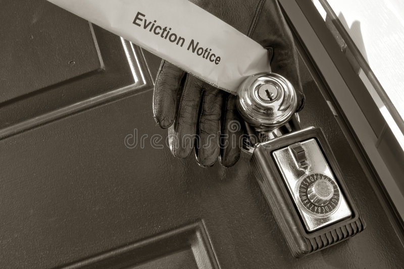 Real Estate Eviction Notice in Sheriff Hand royalty free stock images