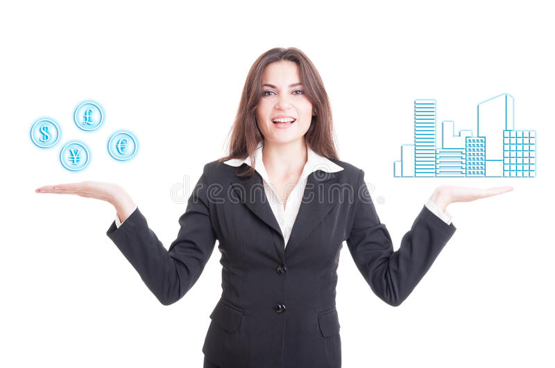 Real estate female agent looking confident. And holding house in one hand and money symbol in the other royalty free stock photography