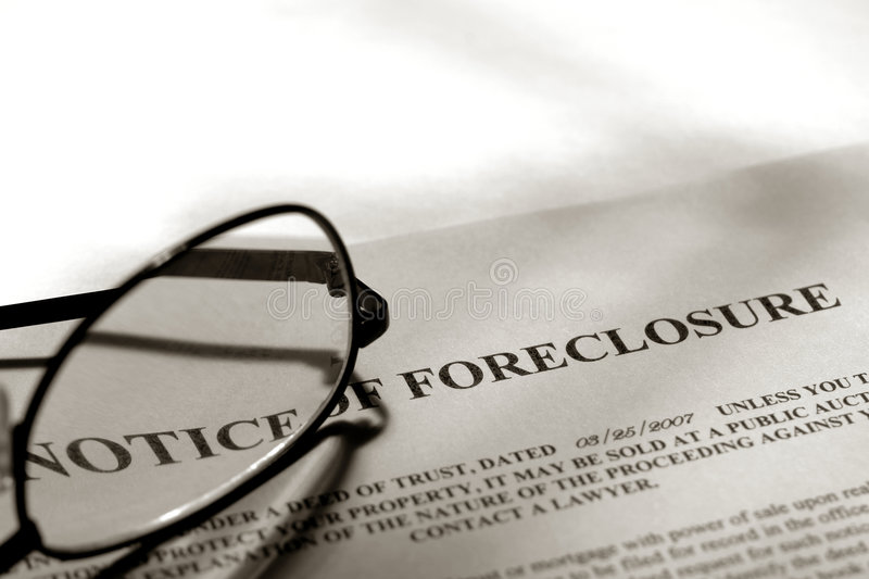 Real Estate Foreclosure Notice and Glasses royalty free stock image
