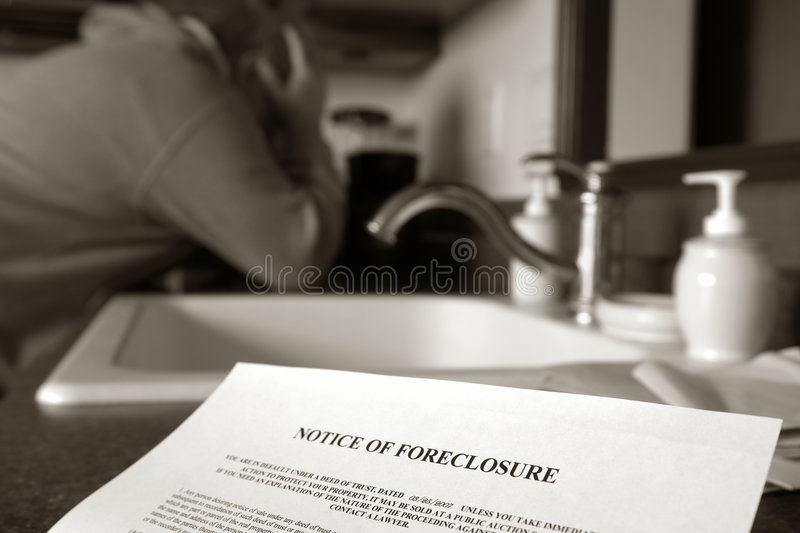 Real Estate Foreclosure Notice and Man Crying stock image