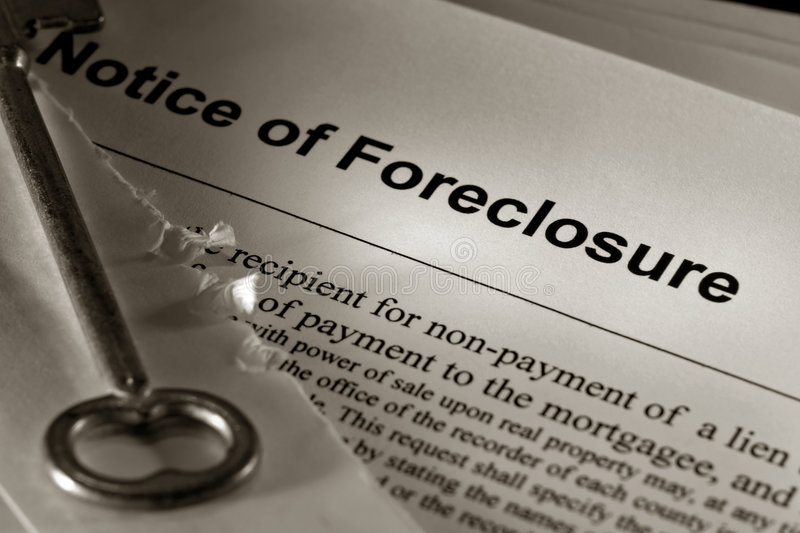 Real Estate Foreclosure Notice with Old House Key stock photos
