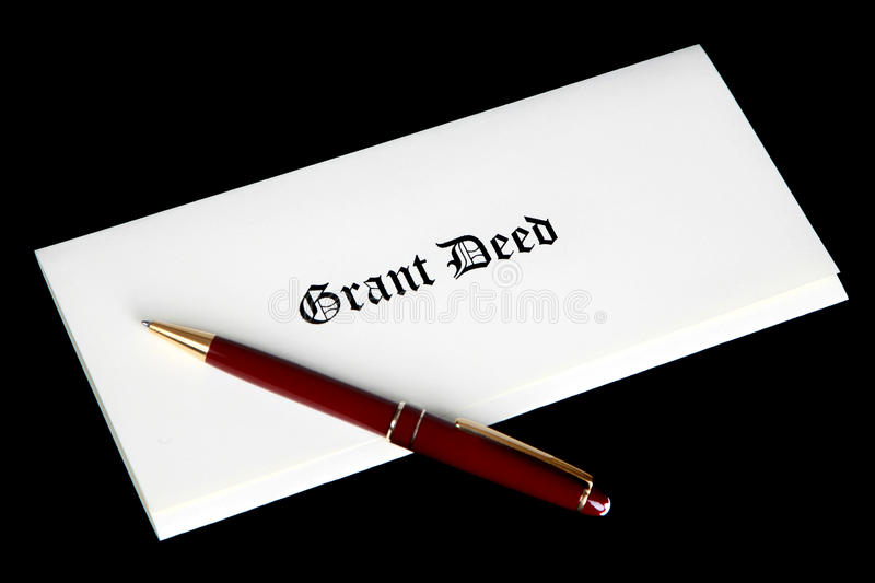 Real Estate Grant Deed Documents. Dramatic image on a black background with high end pen laying across the document stock photos