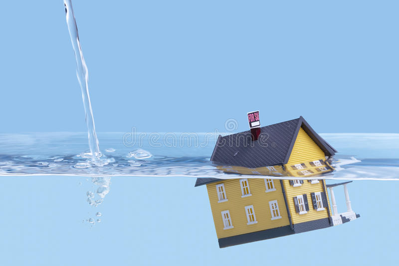 Real Estate, Home mortgage crisis concept. Underwater home mortgage, house for sale, real estate crisis concept, copy space stock images