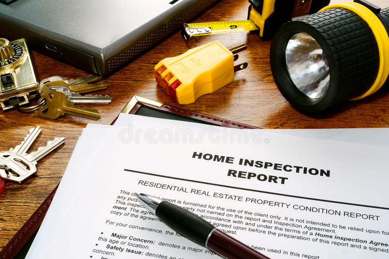 Real Estate Inspector Home Inspection Report File. Real estate home inspection report of resale residential property condition with professional housing royalty free stock photos