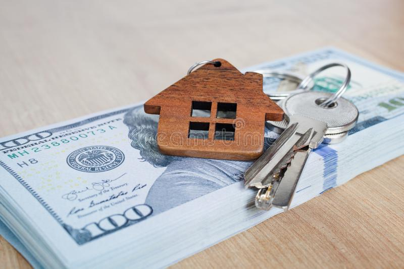Real estate investing concept. American dollar, cash or housing. Keys close-up. Real estate investing concept. American dollar, cash or housing. Keys close up stock photos