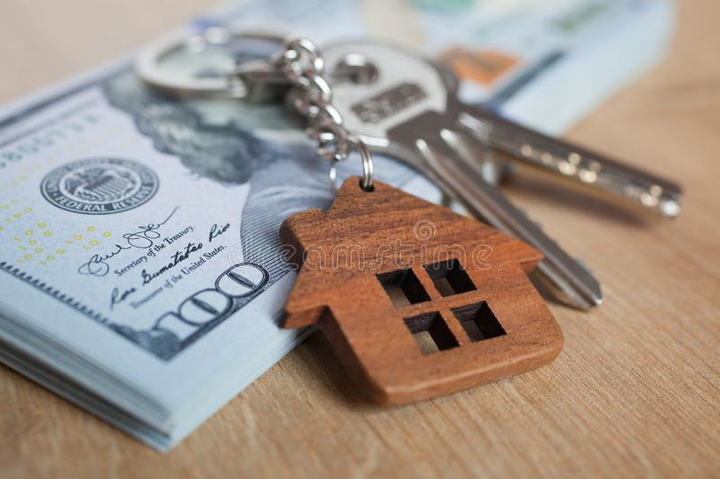 Real estate investing concept. American dollar, cash or housing. Keys close-up. Real estate investing concept. American dollar, cash or housing. Keys close up royalty free stock photography