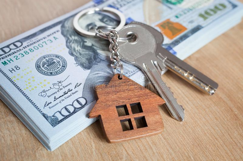 Real estate investing concept. American dollar, cash or housing. Keys close-up royalty free stock images