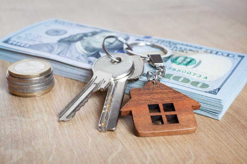 Real estate investing concept. American dollar, cash. Keys close-up. Real estate investing concept. American dollar, cash or housing. Keys close-up royalty free stock photography