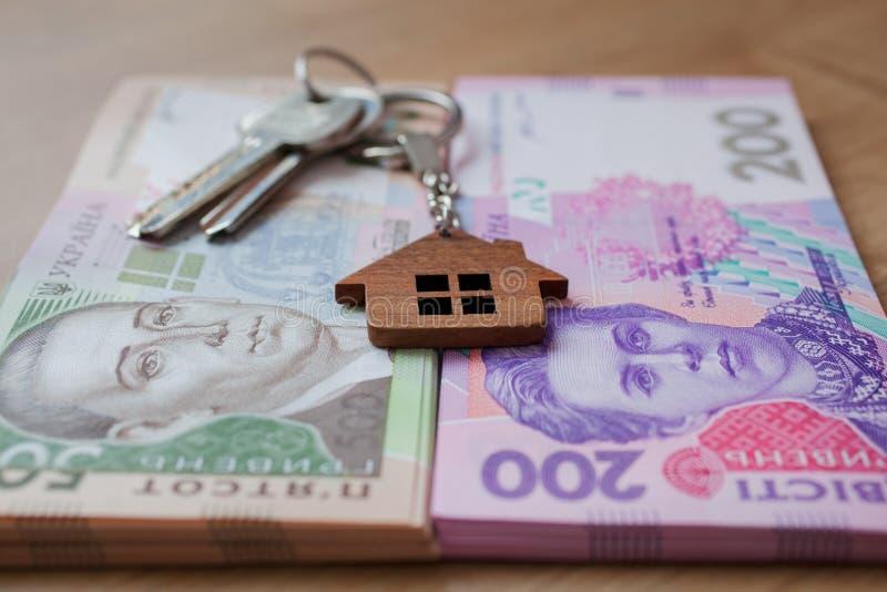Real estate investing concept. Ukrainian hryvnia, cash or housing. Keys close up. Real estate investing concept. Ukrainian hryvnia, cash or housing. Keys close royalty free stock image