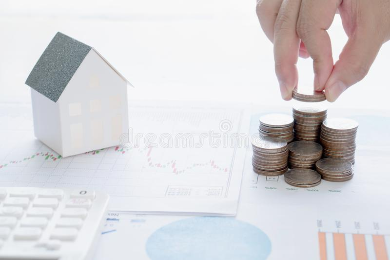 Real estate investment. House and coins. On table royalty free stock images