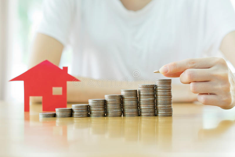 Real estate investment. House and coins. On table royalty free stock photography