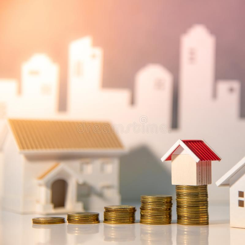 Real estate investment. Property ladder concept. Real estate investment or Home mortgage loan rate. Property ladder concept. Coins stack and house models on the royalty free stock images