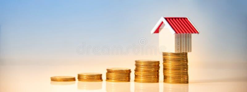Real estate investment. Property ladder concept. Real estate investment or Home mortgage loan rate. Property ladder concept. Gold coins stack and house model on stock images