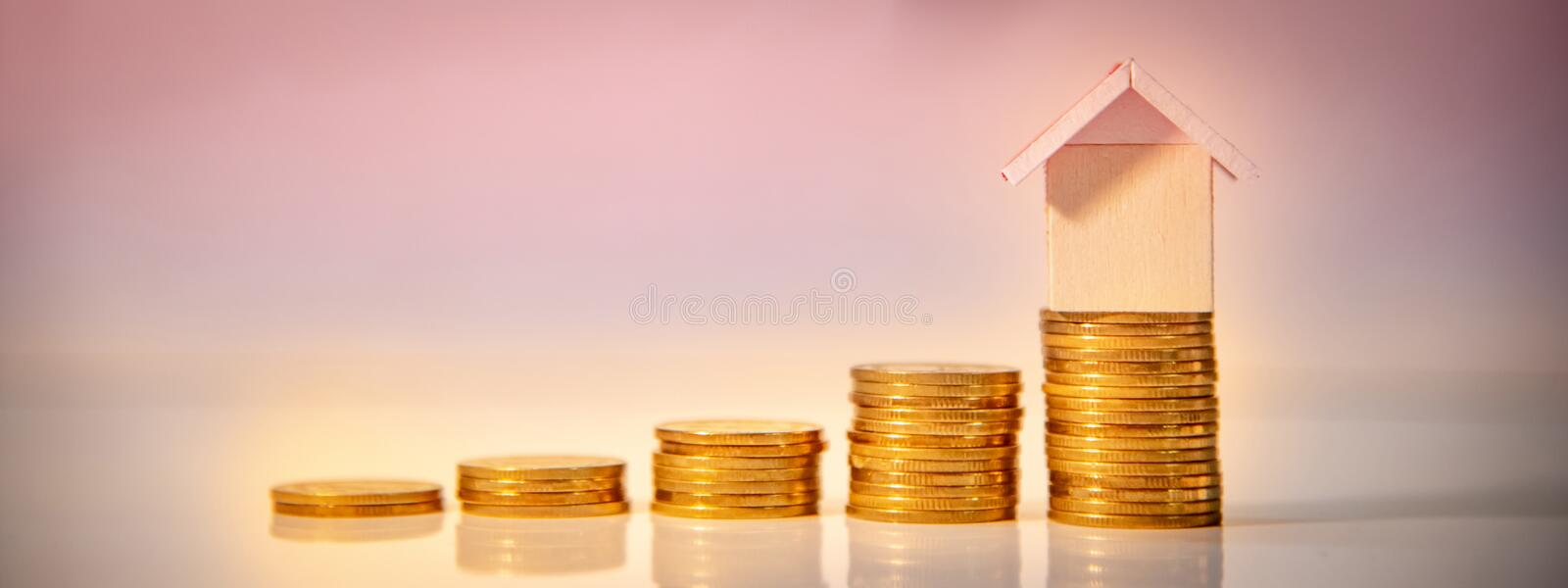 Real estate investment. Property ladder concept. Real estate investment or Home mortgage loan rate. Property ladder concept. Gold coins stack and house model on royalty free stock photos