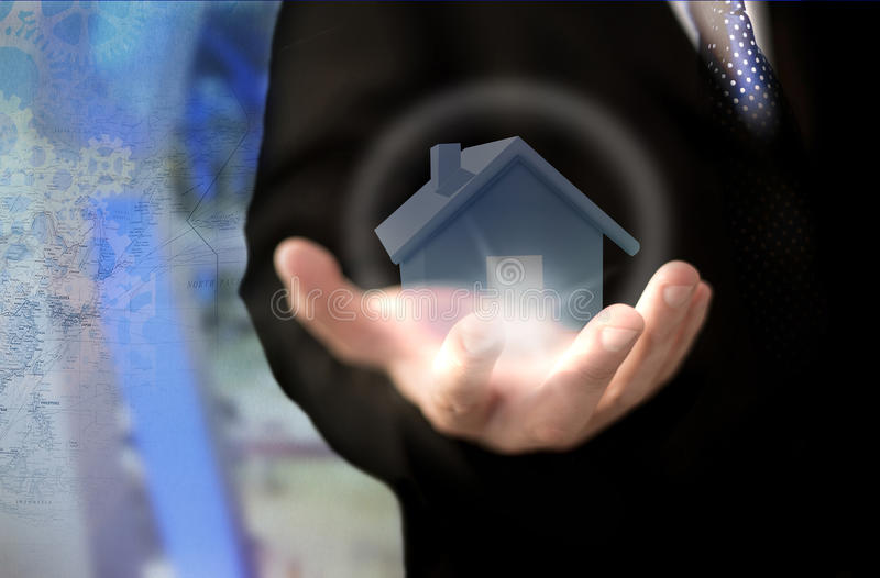 Real estate investment trust concept. Businessman holding house model. Real estate investment trust concept stock image