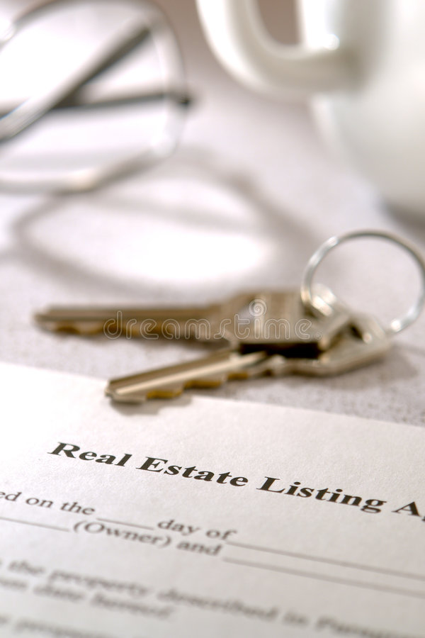 Real Estate Listing Contract and House Keys royalty free stock images