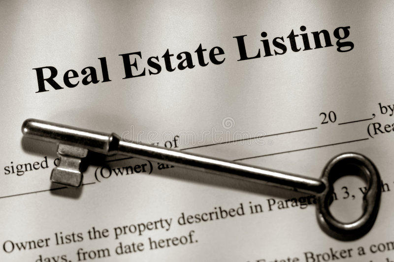 Real Estate Listing Contract and Old House Key stock photo