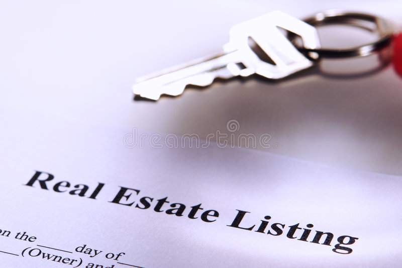 Real Estate Listing Contract and Resale House Key stock photos