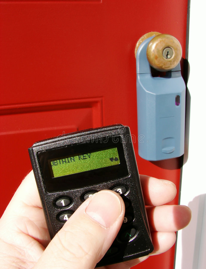 Real Estate Lock Box And Electronic Remote In Hand Stock