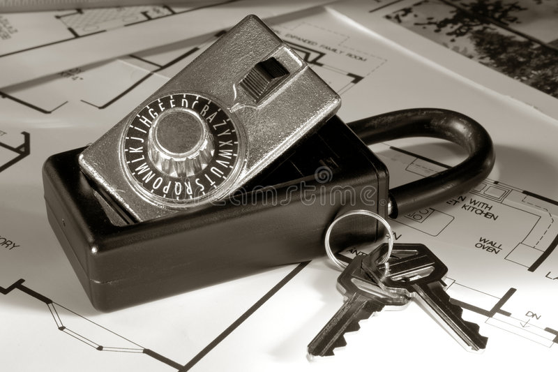 Real Estate Lock Box and Keys on House Floor Plans stock photos
