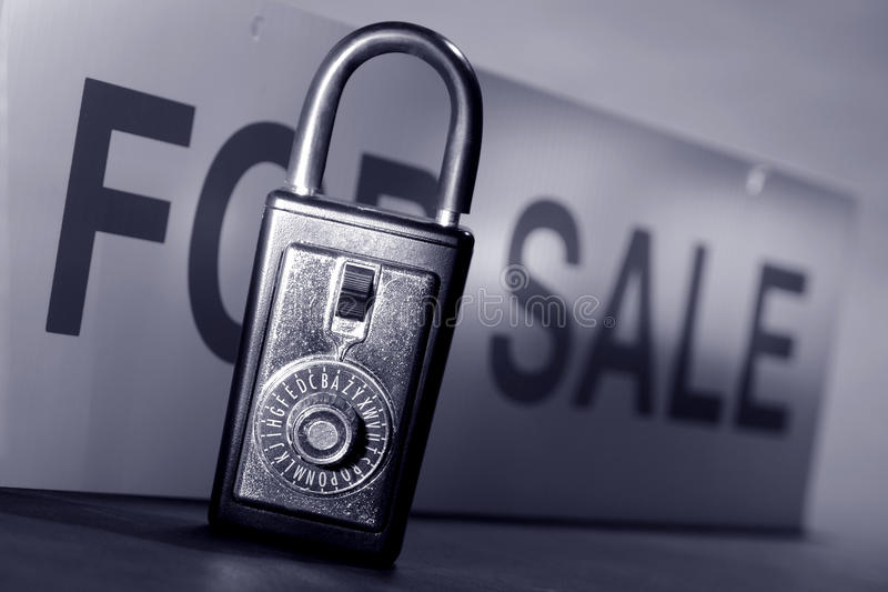 Real Estate Lock Box and For Sale Sign stock images