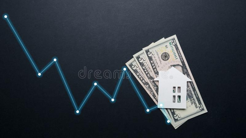 Real estate market concept. Minimalistic paper house on a black background. Top view. Flat lay stock images