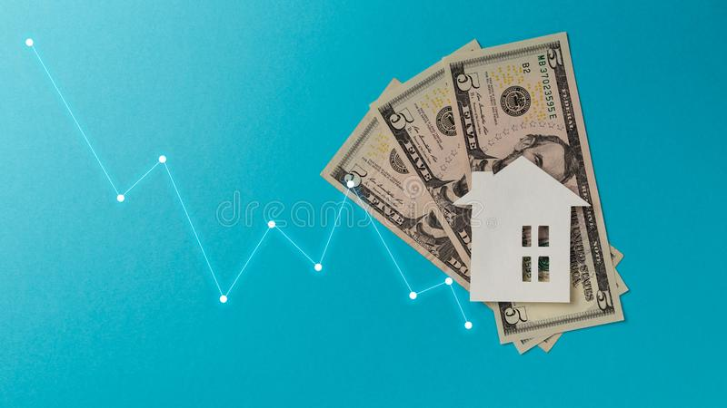Real estate market concept. Minimalistic paper house on a blue background. Top view. Flat lay. Copy space royalty free stock photo