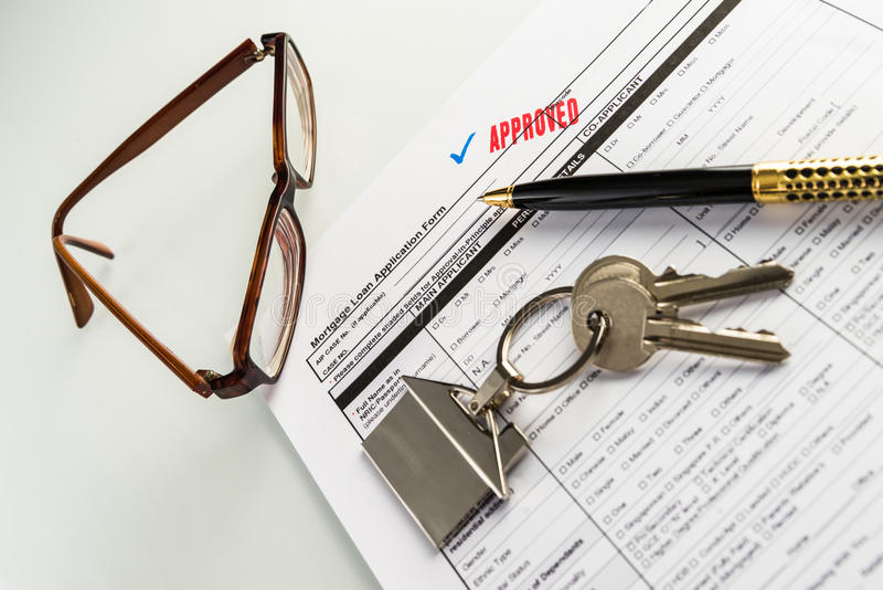 Real Estate Mortgage Approved Loan Agreement. Mortgage Approved Loan Document With House Keys and Ball Pen royalty free stock image